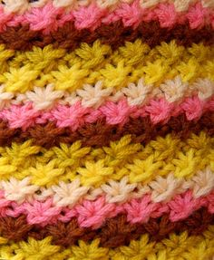This is a knitted star stitch... it looks very similar to the crochet star stitch.  Click through for a detailed tutorial.