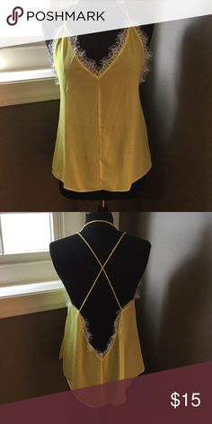🌟🎉HP WEEKEND WARDROBE🎉🌟 Yellow tank with lace NWOT Yellow tank top with lace trim and crisscross back from local boutique. Bought to wear for game days but never worn. Francesca's Collections Tops Tank Tops