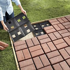"Patio Pal Quick Brick Patio System $29.95 | First build a simple redwood or cedar frame, fill with sand and smooth. Then place Patio Pal forms and your own bricks. Each form has built-in holes for drainage and grooves for perfect brick alignment. Add sand, sweep, and mist with water. That's it! Includes 10 Pals and covers approx 20 sq ft in total. Each is 17 1/2"" sq. x 1/2"" h."