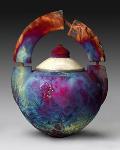 "Greg Milne, retired owner of Raku Vessels, SMALL PARTIAL ARC 20""h x 18.5""w x 15.5""d. ""Over the years, my work has been transformed. Initially, my science background led me to believe that all in nature could be broken down into the simplest of components. My work tried to convey that basic idea, using simple shapes, applying few colors. However, I soon realized that nothing man touches can remain simple. Recently I have begun to focus my attention on this strange aspect of man."""