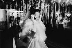 Chien-Chi Chang :: A bride on her cell-phone making last-minute preparations before the ceremony, Taipei, Taiwan, 1998.