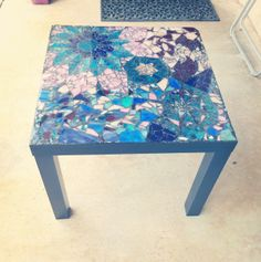 I made a geometric mosaic table top that is crafted from stained glass pieces than grouted to give unique appearance. Two-part epoxy resin is used to secure the table top and imitate a glass form. For sale on claudiasalvat.com, Etsy and Ebay. $179.99