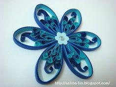 Simple husking technique combined with cascading loops in the middle of each petals. This is the same flower like t...