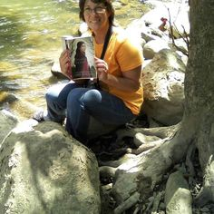 From Sally Shupe: Reading by the river while waiting for the spring log drive! ;-)