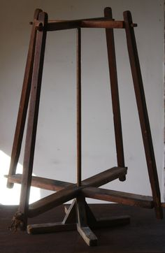 Antique Primitive Swift Yarn Winder 19 C Maine Rotary Frame Original Dark Color.American early swift on canted rotating frame with handcarved slotted ends. Rotates around a central rod.  X-base footing. Winds from a spinning wheel or from skeins of yarn without tangling or knotting.  Original dry surface, great oxidized color.  Very good condition.  No problems or repairs.  A perfect accessory for a sewing, craft or period room.  24 inches high.ebay sold 87.00