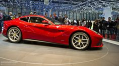 What a beautiful car! Ferrari f12 Berlinetta out in 2013. Can't beat that red either