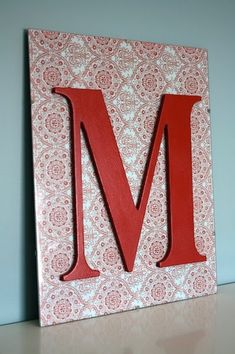 dollar store plain picture frame, wooden letter, craft paper