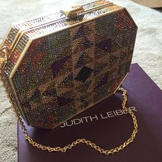 Authentic Judith Leiber Swarovski Crystal Clutch. Authentic Judith Leiber Swarovski Crystal Clutch. Brand new. Box included. Geometric design. Very rare. MAKE ME AN OFFER  Judith leiber Bags Clutches & Wristlets