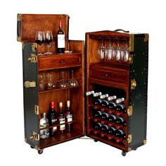 Vintage steamer trunk converted into a one-of-a-kind bar cabinet with plenty of storage and a flip-top drink prep area.  A very cool bar cart and conversation piece!