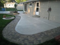 Even with a tradition broom finish, adding a decorative stamped concrete edge to a patio will transform the patio into an eye catching hardscape. The edge features a cobblestone brick look. Easy maintenance and will last for many years to come.