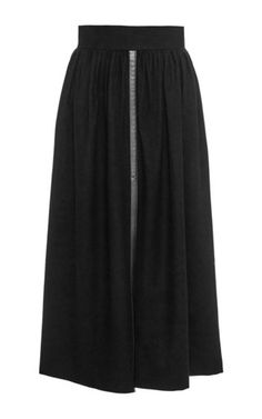 In honor of her heritage, Olga Vilshenko fuses Russian folklore influences with Western couture disciplines for a pre-fall '15 collection rich with opulent textiles and embellishments. This **Vilshenko** skirt is rendered in a wool and cashmere blend and features a high rise gathered waist with a wide waistband, a leather trim with a split down the front and a mid calf length a line silhouette.