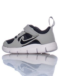 NIKE free run 3 Low top infant/toddler sneaker Velcro closure Signature NIKE swoosh on sides of shoe Mesh detail Flexible material Cushioned sole for comfort