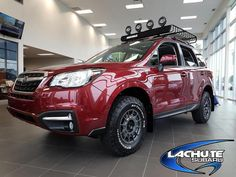 "Brand: Subaru Model: Forester 2.5i Year: 2017Color: Venetian Red Pearl Lift kit: LP Aventure 2""Tires: 235/75/15 BFGoodrich All Terrain T/A KO2 Wheels: Team Dynamics Pro Rally 1 Cargo Basket: Yakima Megawarrior Lights: Hella 500Mud flaps: Rally Armor"