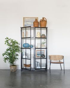 Our favorite feature of the Amalie Cabinet is its windowpane detail, allowing a stark white interior to contrast with a black iron frame. This transitional piece includes glass doors and ample shelves for maximum storage and display options.