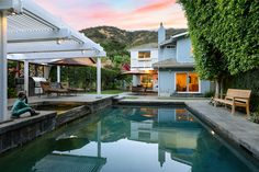 3289 MANDEVILLE CANYON RD., BRENTWOOD, CA 90049 5 BR + 4 BA  |  $3,695,000 Agent: Susan Stark  Bask in luxury at this modern mini-estate designed by architect John Payne. This hillside oasis is replete with a pool, spa, built-in BBQ, fruit trees, and several elegant lounging areas.