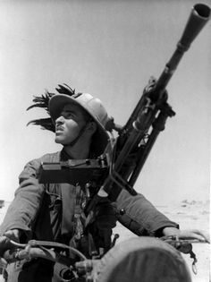 Portrait of an Italian Bersaglieri (Marksman) on a motorcycle with a Breda 30 light machine gun during the Western Desert Campaign, shortly before the Axis Italian invasion of Egypt. The Bersaglieri have always been a high-mobility light infantry...