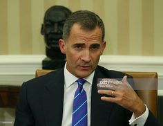 King Felipe VI of Spain speaks while seated in front of a bust of Dr. Martin Luther King Jr. during a meeting with US President Barack Obama in the Oval Office at the White House September 15, 2015 in Washington, DC. King Felipe VI and Queen Letizia are visiting Washington in an effort to reinforce the American-Spanish relationship.