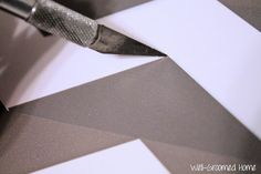 Well-Groomed Home: Applying Contact Paper lining up contact paper pattern