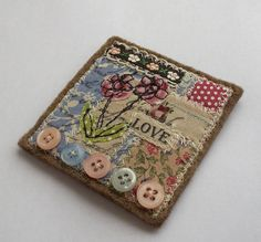sewing and textiles brooch by pantsandpaper. Super idea for ladies group to do together. I can almost hear the laughter!