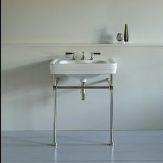 Image result for 2008, soho basin taps in aged brass with charcoal black levers,
