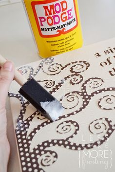 I need to try this ~ mod podge canvas idea