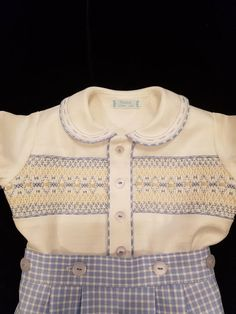 Classic smocking design, perfect for your favorite smocked-insert garment. Done with basic smocking stitches. Accents are satin stitch and bullion knots. While suitable for a boys special baptism or christening outfit, this design may also be used for girls smocked yoke dresses. The Smocking Plates, Smocking Patterns, Baby Boy Baptism Outfit, Baby Boy Outfits, Kids Outfits, Smocked Baby Clothes, Smocked Dresses, Childrens Coats, Punto Smok