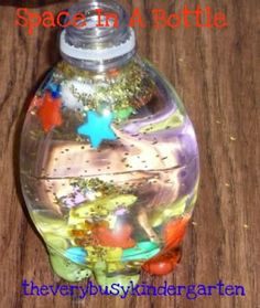 Space in a bottle... water, pom poms for planets, star beads for stars, sparkles for asteroids.. etc.