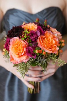 A perfect orange color wedding bouquet for a Fall wedding; Click to see more details of this gorgeous wedding; photo: Sweetwater Portraits