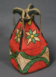 Africa | Yoruba Crown. Benin. 20th century | beads sewn to thickly layered cotton cloth and lined with old cut velvet cloth; motifs of 8-pointed stars and geometric patterns