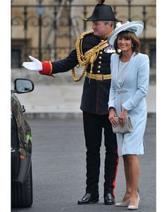 The bride's mother, Carole Middleton, shows off a  Catherine Walker wool crepe coatdress and silk shantung day dress. Her hat is by milliner Jane Corbett.   - HarpersBAZAAR.com