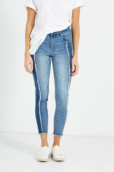 Everything you love about a skinny, but with a bit more edge. Available in a range of colours and washes, this distressed jean is the easiest way to kick your look up a notch.<br /><br /> - Skinny fit designed to firmly hug the body<br /> - Mid rise waistline<br /> - 7/8, above the ankle length<br /> - Zip fly<br /> - Belt loops<br /> - Five pocket styling<br /> - Ripped detail<br /> - Dis...