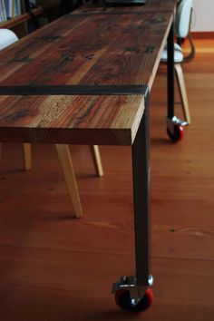industrial table w/ reclaimed wood and casters
