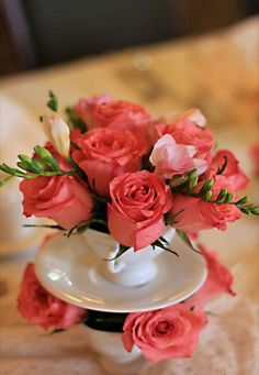 Salmon pink color roses in porcelain cup
