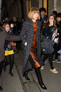 Anna Wintour gave a lesson in sophisticated styling, pairing a landscape-print dress and black leather boots with a long tweed coat on her way to the Rochas show during #PFW.