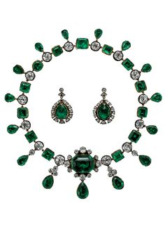 Emeralds of Empress Ekaterina II of Russia, c.1830. The necklace is composed of a graduated row of step-cut emeralds, each in pierced raised gold collets, alternating with cushion shaped diamonds in silver collets, fringed with pear shaped emeralds , meeting at a detachable central octagonal domed emerald within a border of cushion shaped diamonds hung with an emerald drop, fastened by an emerald clasp. Each earring is composed of an emerald briolette within an openwork diamond border.