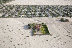 TIME's Top 10 Photos of 2015. Each photograph carefully culled from thousands and presented here unranked reflects a unique and powerful point of view that represents the best of photojournalism this year. Damon Winters (@damonwinter) enterprising picture of properties surrounded by the desert in Rancho Mirage provides insight into the California drought and its deep-reaching consequences. Photographing from an R22 helicopter Damon told TIME he hoped to show the extreme lengths we go to live…