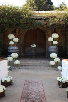 Winery wedding. Nice idea for flower display.