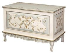 This elegant French toy box has been hand painted with blue, linen and gold paints. The toy chest measures 37