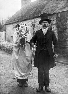 The Mari Lwyd with the leader of the mummers, who was traditionally top-hatted and dressed in funereal black.