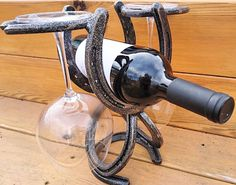 This is my official wine rack style. I have changed the size of the horseshoes to better fit larger wine bottles and also to better fit the glasses. Made by Rachel Bohnet at Country Custom Fabricating