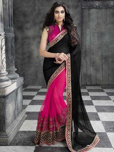 Vivacious rani pink and black color saree invented on net and chiffon with golden zari work. Item Code : SAV8620 http://www.bharatplaza.com/new-arrivals/sarees.html