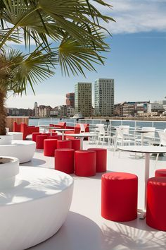 Terrace Lido of the Badboot, 'Swimming pool boat', world's largest open air floating swimming pool. The terrace offers a nice view over Antwerp. The designers chose the red colored lounging chairs for contrast.