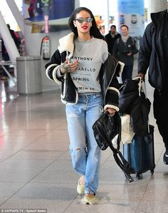 Low-key glamour: Rihanna matched her furry footwear and shades with baggy jeans, a fashion...