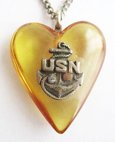 Vintage US Navy Prystal Bakelite Heart with Anchor Sweetheart Pendant Necklace. $85.00, via Etsy.