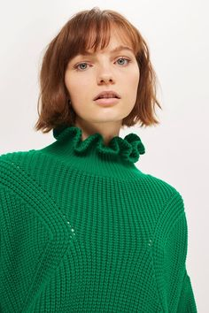 Achieve contemprary casual with this frill neck knit jumper in bold green. We're styling it with wide-leg cropped jeans for a relaxed take on daytime dressing.