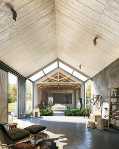 Volume and scale in this living space. Love the tongue and groove panelled…