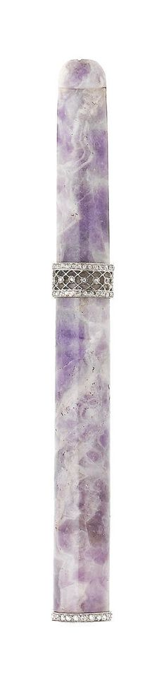 A jade and diamond cigarette holder The polished lavender jade, overlaid with courses of rose-cut diamonds, jade untested, length 11.7cm (illustrated above)