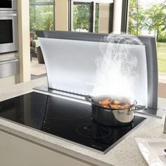I wonder how good the ventilation is? Jenn-Air Induction Cooktop with Downdraft Ventilation Kitchen Ventilation, Ventilation System, Jenn Air Appliances, Kitchen Appliances, Wolf Appliances, Kitchen Stove, New Kitchen, Smart Kitchen, Island Cooktop