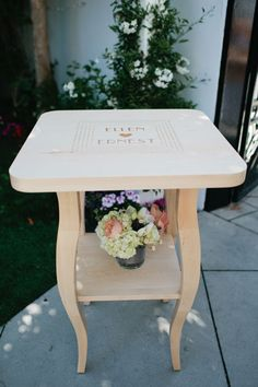 An Interactive Guest Book  Instead of settling for a regular spiral-bound notebook, this is a place where you can really use your imagination and get creative, even if youre having a more formal wedding. This couple asked loved ones to sign this wooden table with their wishes and remarks. After the wedding, they displayed it in their home, as a constant reminder of their big day!  Wedding Planner: Nancy Park/So Happi Together