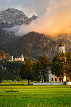 View on Neuschwanstein Castle and Alps ~ in the background & St. Sebastian church in Ramsau, Bavaria ~ Germany
